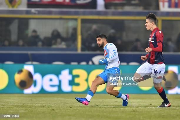 Napoli's midfielder from Italy Lorenzo Insigne kicks and scores during the Italian Serie A football match Bologna vs Napoli at 'Renato Dall'Ara...