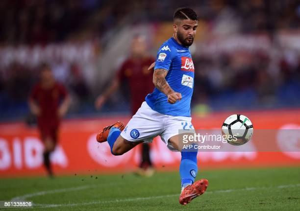 Napoli's midfielder from Italy Lorenzo Insigne kicks the ball during the Italian Serie A football match Roma vs Napoli at the Olympic Stadium in Rome...