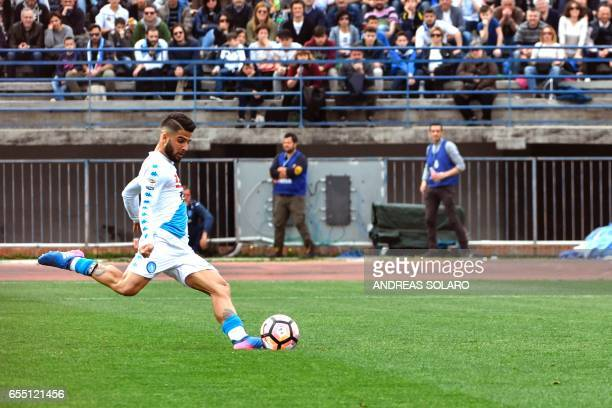 Napoli's midfielder from Italy Lorenzo Insigne shoots and scores the penalty against Empoli during the Italian Serie A football match Empoli versus...