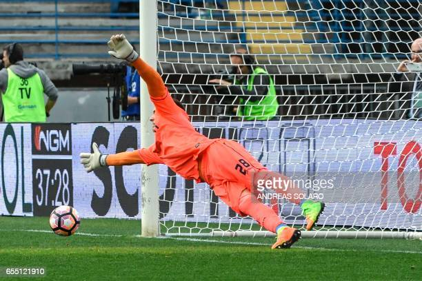 Napoli's midfielder from Italy Lorenzo Insigne shoots and scores the penalty against Empoli's goalkeeper from Poland Lukasz Skorupski during the...