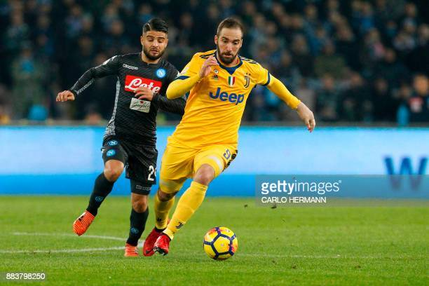 Napoli's midfielder from Italy Lorenzo Insigne vies with Juventus' forward from Argentina Gonzalo Higuain during the Italian Serie A football match...