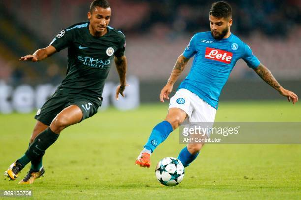 Napoli's midfielder from Italy Lorenzo Insigne vies with Manchester City's Brazilian defender Danilo during the UEFA Champions League football match...