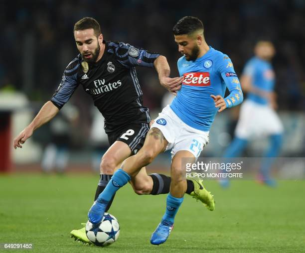 Napoli's midfielder from Italy Lorenzo Insigne vies with Real Madrid's defender Dani Carvajal during the UEFA Champions League football match SSC...