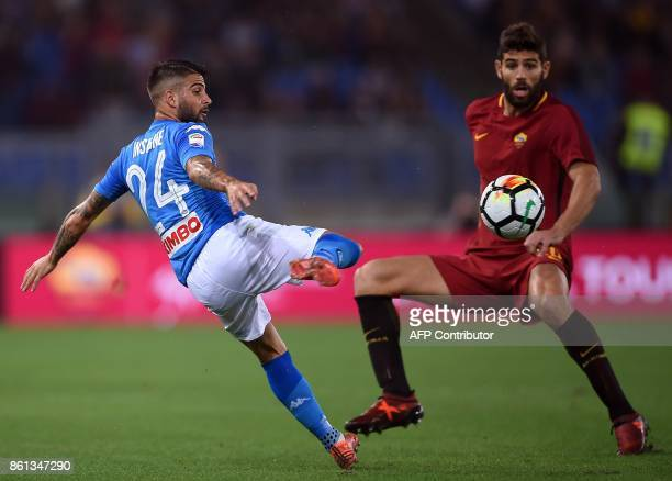 Napoli's midfielder from Italy Lorenzo Insigne vies with Roma's defender from Argentina Federico Fazio during the Italian Serie A football match Roma...