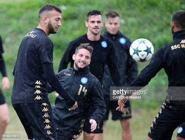 Napoli's midfielder from Morocco Omar El Kaddouri Napoli's forward from Belgium Dries Mertens and Napoli's defender from Italy Christian Maggio take...