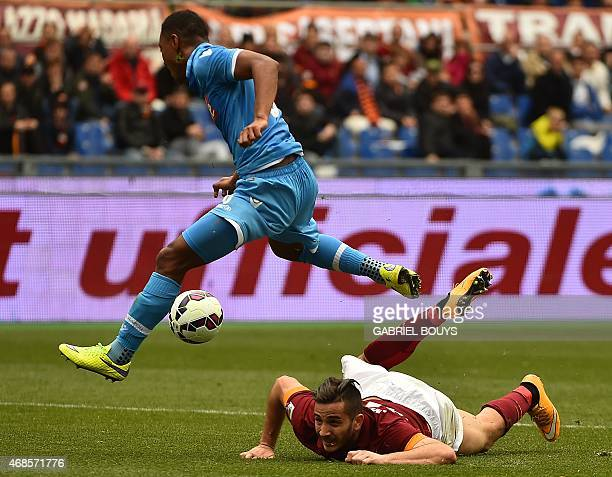Napoli's midfielder from Netherlands Jonathan De Guzman vies with Roma's defender from Greece Konstantinos Manolas during the Italian Serie A...