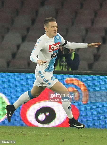 Napoli's midfielder from Poland Piotr Zielinski celebrates after scoring during the Italian Serie A football match SSC Napoli vs Inter Milan on...