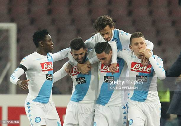 Napoli's midfielder from Poland Piotr Zielinski celebrates with teammates after scoring during the Italian Serie A football match SSC Napoli vs Inter...