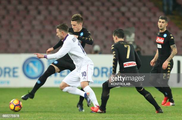 Napoli's midfielder from Poland Piotr Zielinski fights for the ball with Fiorentina's midfielder from Italy Federico Bernardeschi near teammates...