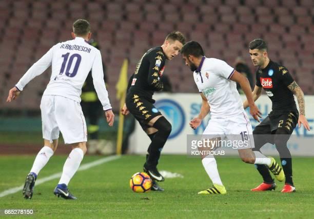 Napoli's midfielder from Poland Piotr Zielinski fights for the ball with Fiorentina's defender from Uruguay Maximiliano Olivera near Napoli's...