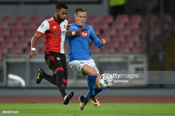 Napoli's midfielder from Poland Piotr Zielinski fights for the ball with Feyenoord's Dutch defender Jeremiah St Juste during the UEFA Champion's...