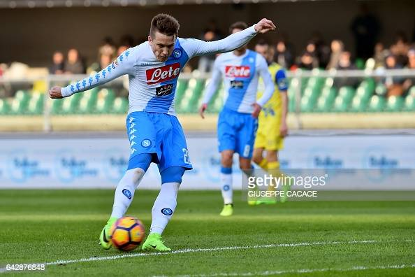 Napoli's midfielder from Poland Piotr Zielinski kicks and scores during the Italian Serie A football match Chievo vs Napoli at 'Bentegodi Stadium' in...