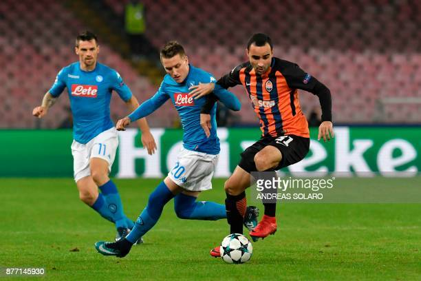 Napoli's midfielder from Poland Piotr Zielinski vies with Shakhtar Donetsk's Brazilian defender Ismaily during the UEFA Champions League Group F...