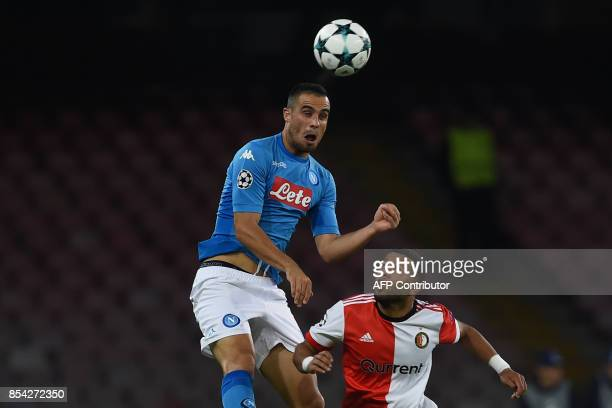 Napoli's midfielder from Serbia Nikola Maksimovic heads the ball next to Feyenoord's Dutch midfielder Tonny Vilhena during the UEFA Champion's League...
