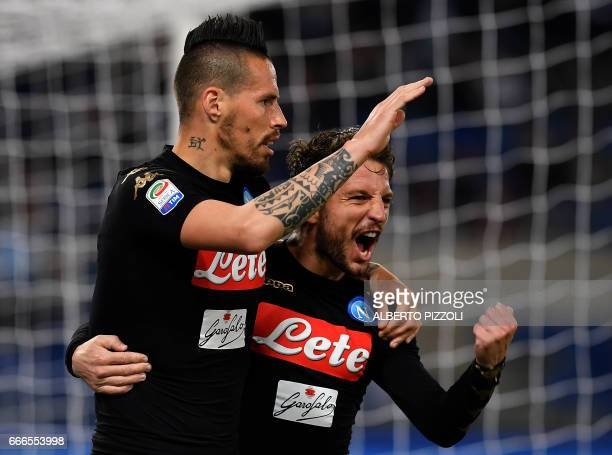Napoli's midfielder from Slovakia Marek Hamsik and Napoli's forward from Belgium Dries Mertens celebrates the goal by teammate Napoli's forward from...