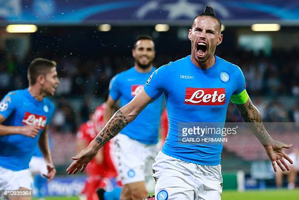Napoli's midfielder from Slovakia Marek Hamsik celebrates after scoring during the UEFA Champions League football match SSC Napoli vs SL Benfica on...