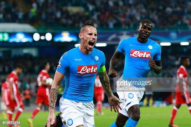 Napoli's midfielder from Slovakia Marek Hamsik celebrates with teammate Napoli's defender from France Kalidou Koulibaly after scoring during the UEFA...