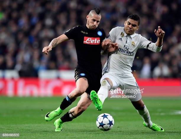 Napoli's midfielder from Slovakia Marek Hamsik vies with Real Madrid's Brazilian midfielder Casemiro during the UEFA Champions League round of 16...