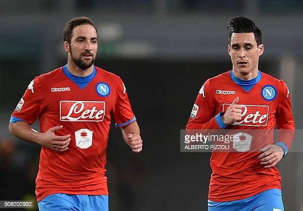 Napoli's midfielder from Spain Jose Maria Callejon celebrates with Napoli's forward from Argentina Gonzalo Higuain after scoring during the Italian...