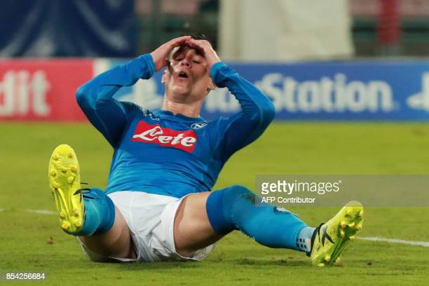 Napoli's midfielder from Spain Jose Maria Callejon reacts after missing a goal during the UEFA Champion's League Group F football match Napoli vs...