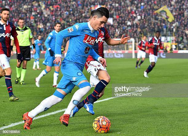 Napoli's midfielder from Spain Jose Maria Callejon vies Bologna's defender from Morocco Adam Masina during the Italian Serie A football match Carpi...