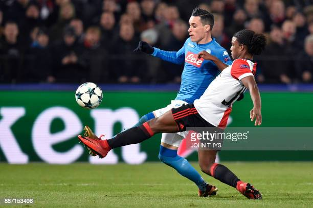 Napoli's midfielder from Spain Jose Maria Callejon vies for the ball with Feyenoord's Dutch defender Tyrell Malacia during the UEFA Champions League...