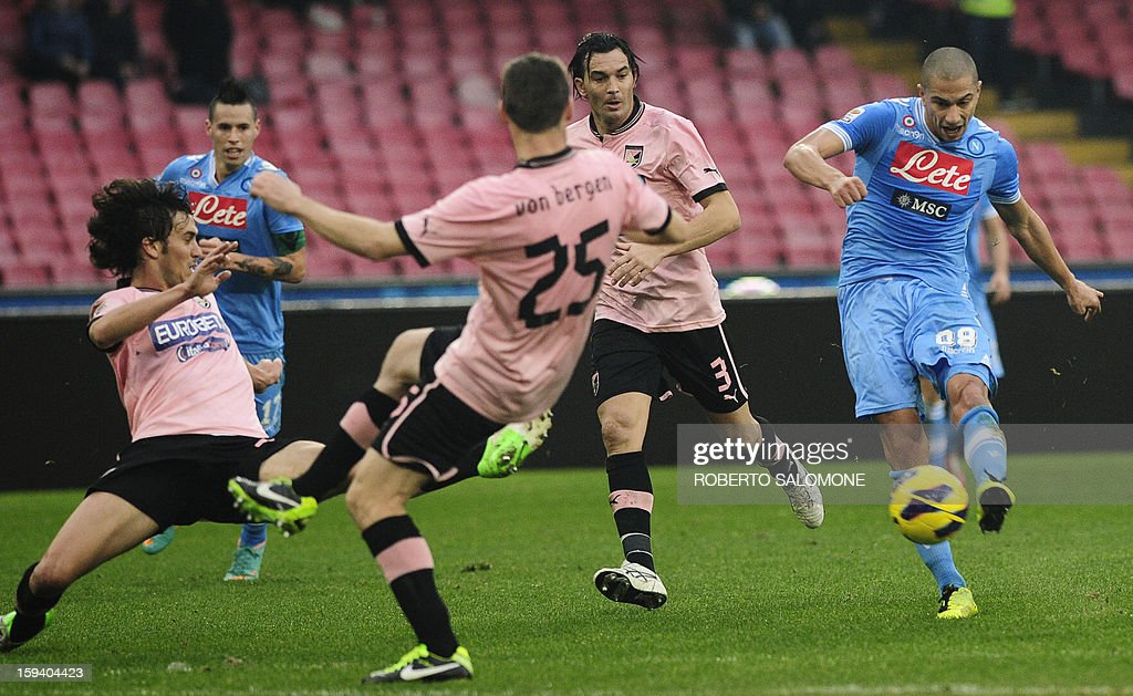 Napoli's midfielder Gokhan Inler (R) shoots to score during an Italian Serie A football match SSC Napoli vs US Palermo at San Paolo Stadium in Naples on January 13, 2013. AFP PHOTO / ROBERTO SALOMONE