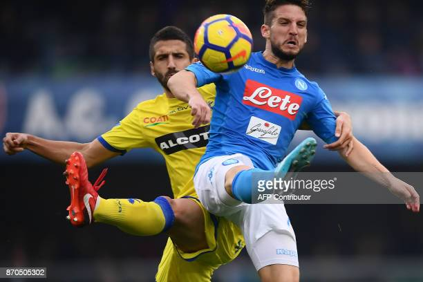 TOPSHOT Napoli's midfielder Jorge Luiz Frello Jorginho from Brazil fights for the ball with Chievo defender's Nenad Tomovic from Serbia during the...