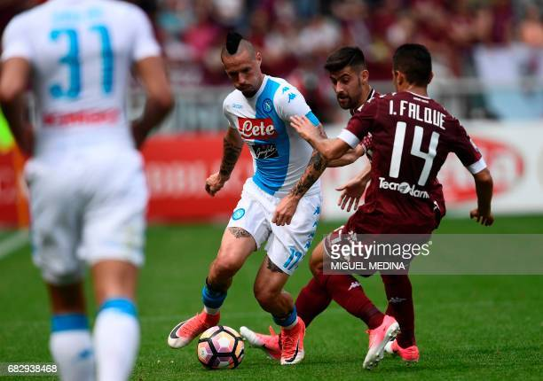 Napoli's midfielder of Slovakia Marek Hamsik vies with Torino's Spanish forward Iago Falque during the Italian Serie A football match Torino vs...