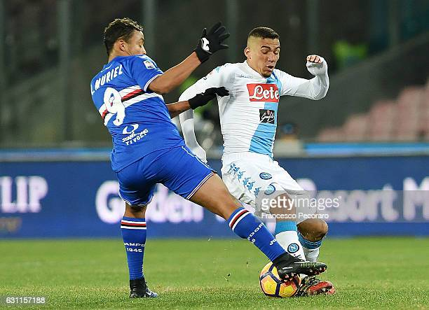 Napolis player Allan vies with UC Sampdoria player Luis Muriel during the Serie A match between SSC Napoli and UC Sampdoria at Stadio San Paolo on...