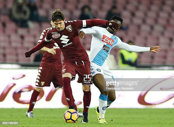 Napolis player Amadou Diawara vies with FC Torino player Sasa Lukic during the Serie A match between SSC Napoli and FC Torino at Stadio San Paolo on...