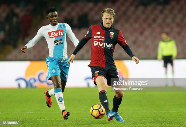 Napolis player Amadou Diawara vies with Genoa CFC player Oscar Hiljemark during the Serie A match between SSC Napoli and Genoa CFC at Stadio San...