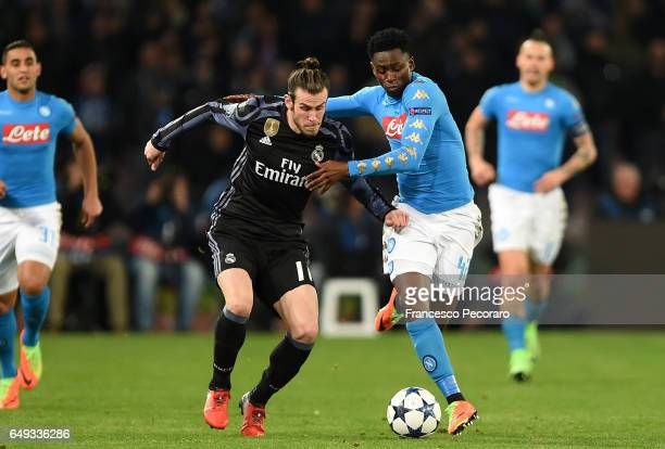 Napolis player Amadou Diawara vies with Real Madrid CF player Gareth Bale during the UEFA Champions League Round of 16 second leg match between SSC...