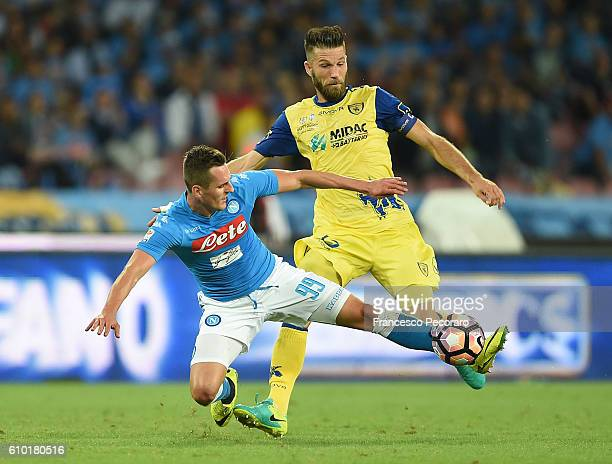 Napolis player Arkadiusz Milik vies with AC ChievoVerona player Bostjan Cesar during the Serie A match between SSC Napoli and AC ChievoVerona at...