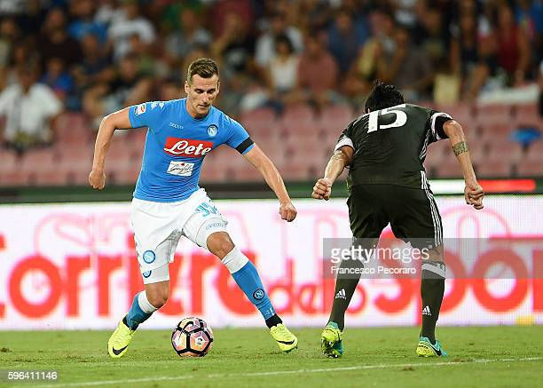 Napoli's player Arkadiusz Milik vies with AC Milan player Alessio Romagnoli during the Serie A match between SSC Napoli and AC Milan at Stadio San...