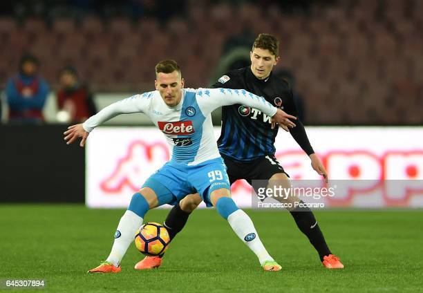 Napolis player Arkadiusz Milik vies with Atalanta BC player Mattia Caldara during the Serie A match between SSC Napoli and Atalanta BC at Stadio San...