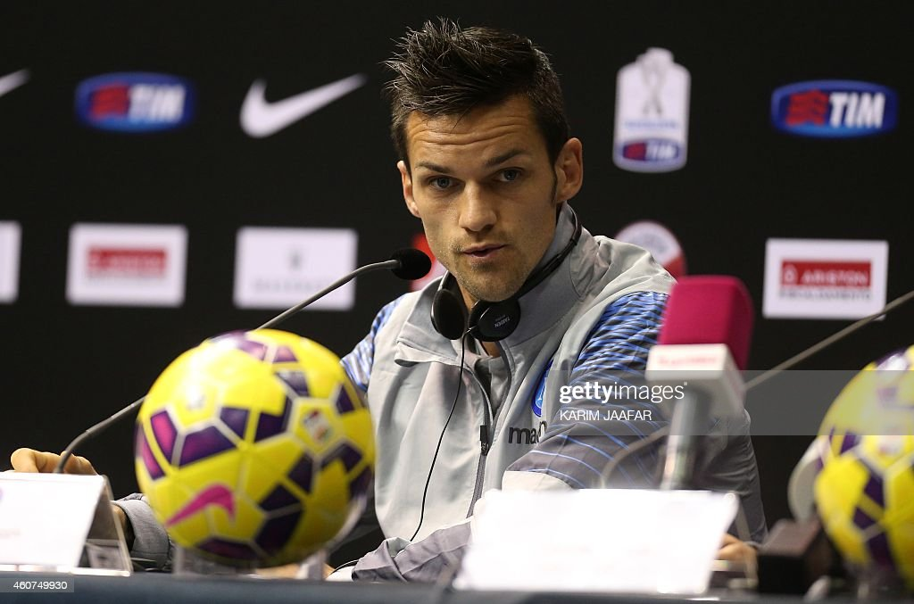 Napoli's player <a gi-track='captionPersonalityLinkClicked' href=/galleries/search?phrase=Christian+Maggio&family=editorial&specificpeople=2131601 ng-click='$event.stopPropagation()'>Christian Maggio</a> gives a press conference in the Qatari capital Doha on December 21, 2014, on the eve of the Italian Super Cup final football match between Juventus and Napoli.