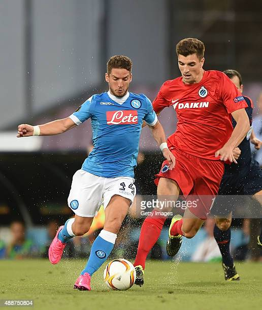 Napoli's player Dries Mertens vies with Club Brugge player Thomas Meunier during the UEFA Europa League match between Napoli and Club Brugge KV on...