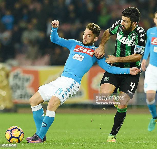 Napolis player Dries Mertens vies with US Sassuolo player Francesco Magnanelli during the Serie A match between SSC Napoli and US Sassuolo November...