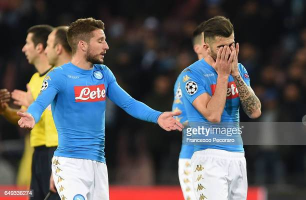 Napolis player Elseid Hysaj and Dries Mertens stand disappointed during the UEFA Champions League Round of 16 second leg match between SSC Napoli and...