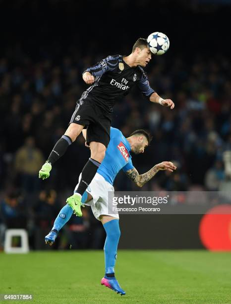 Napolis player Elseid Hysaj vies with Real Madrid CF player Cristiano Ronaldo during the UEFA Champions League Round of 16 second leg match between...