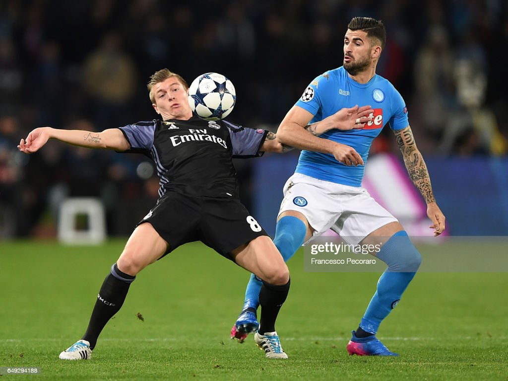 Napolis player Elsied Hysaj vies with Real Madrid CF player Toni Kroos during the UEFA Champions League Round of 16 second leg match between SSC Napoli and Real Madrid CF at Stadio San Paolo on March 7, 2017 in Naples, Italy.