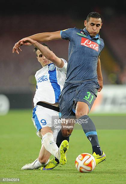Napoli's player Faouzi Ghoulam vies with FC Dnipro Dnipropetrovsk player Nikola Kalinic during the UEFA Europa League Semi Final between SSC Napoli...