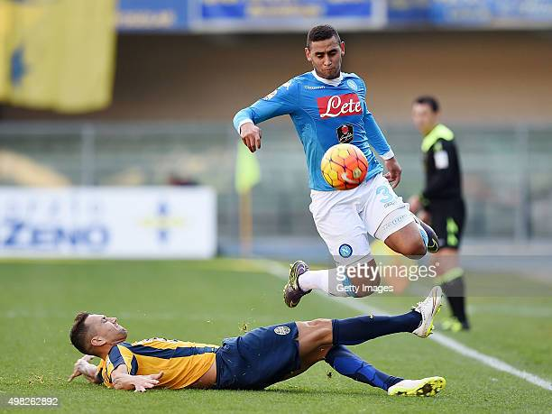 Napoli's player Faouzi Ghoulam vies with Hellas Verona player Bosko Jankovic during the Serie A match between Hellas Verona FC and SSC Napoli at...