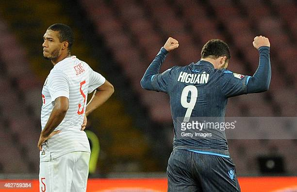 Napoli's player Gonzalo Higuain celebrates after scoring the 10 goal beside the disappointment of Juan Jesus player of FC Internazionale during the...
