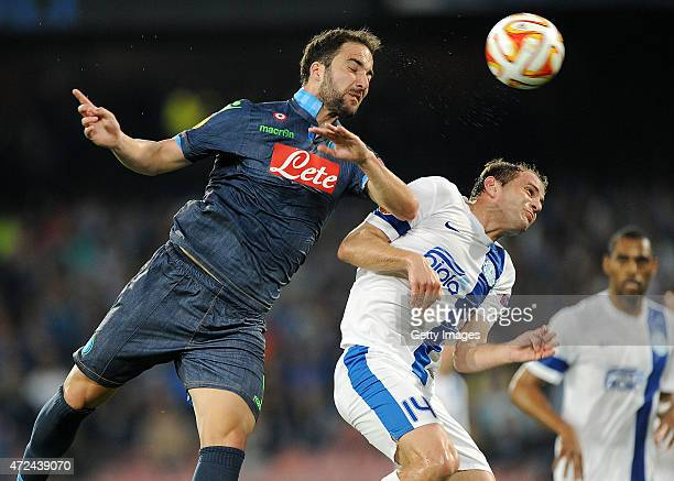 Napoli's player Gonzalo Higuain vies with FC Dnipro Dnipropetrovsk player Yevhen Cheberyachko during the UEFA Europa League Semi Final between SSC...