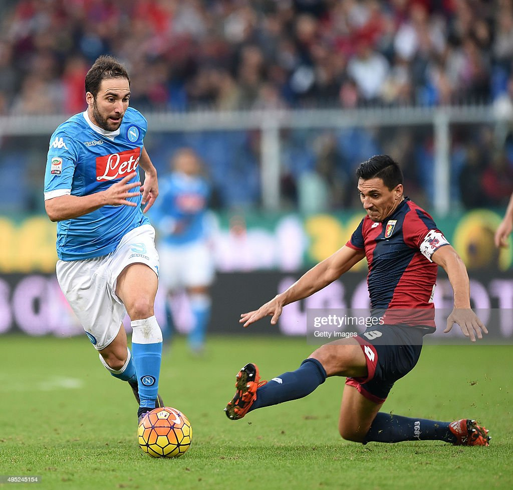 Napoli's player Gonzalo Higuain vies with Genoa player Nicolas Burdisso during the Serie A match between Genoa CFC and SSC Napoli at Stadio Luigi...