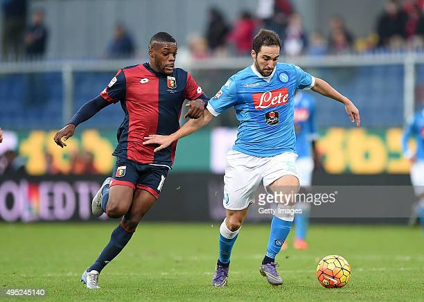 Napoli's player Gonzalo Higuain vies with Genoa player Olivier Ntcham during the Serie A match between Genoa CFC and SSC Napoli at Stadio Luigi...