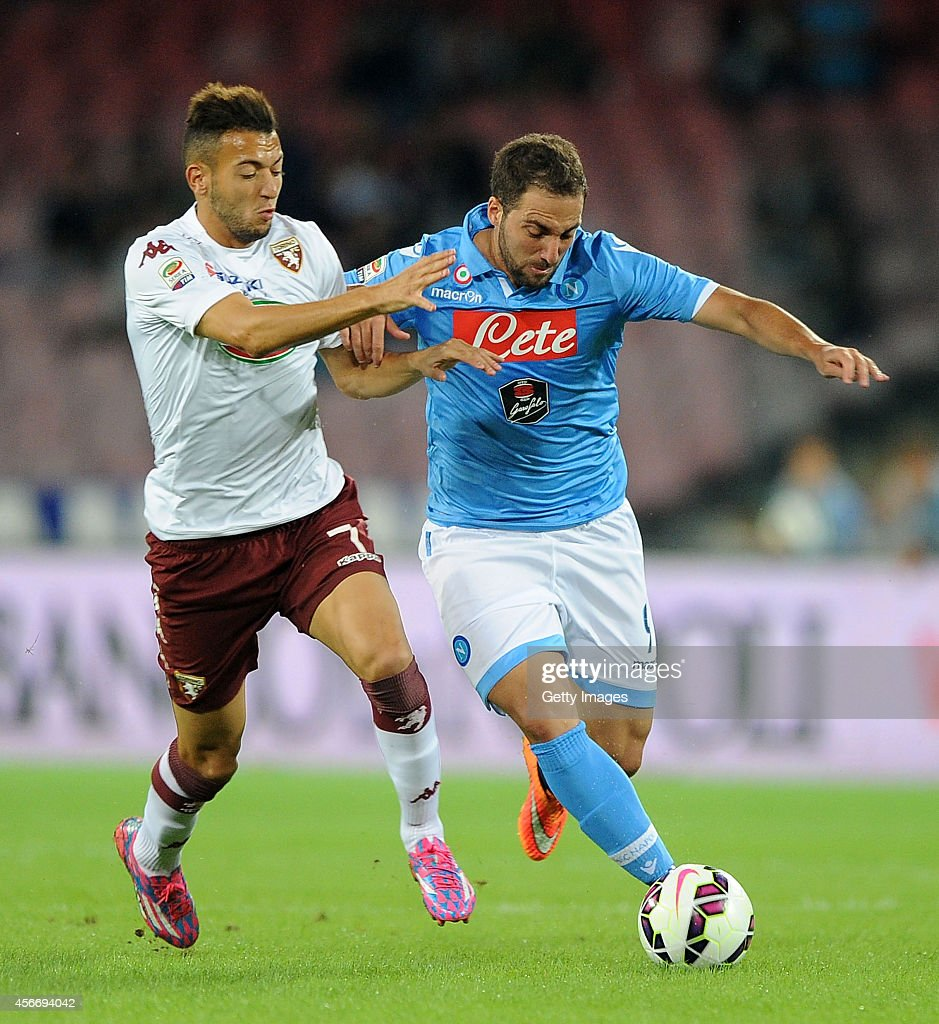 Napoli's player Gonzalo Higuain vies with Torino's player Omar El Kaddouri during an Italian Serie A football match SSC Napoli vs Torino at the San Paolo Stadium in Naples on October 5, 2014.