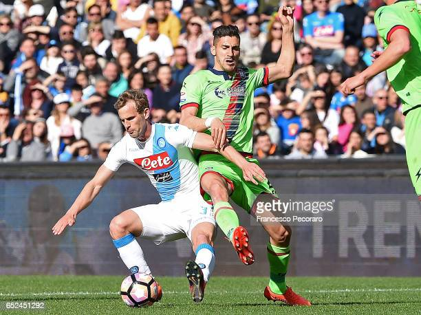 Napoli's player Ivan Strinic vies with FC Crotone player Diego Falcinelli during the Serie A match between SSC Napoli and FC Crotone at Stadio San...